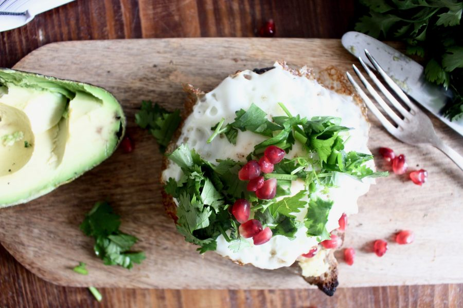 healthy avocado bread with egg pomegranate breakfast toast